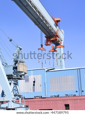 Wharf or shipyard of Hamburg Harbor, Germany. Harbor cranes and production halls at a commercial dock. Industry buildings. - stock photo