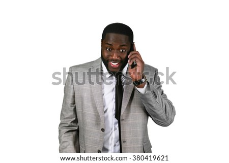 What a lucky day. Exciting phone talk. Happy afroamerican on the phone. Businessman is very excited. - stock photo