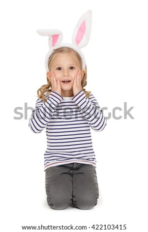 What a surprise! Studio portrait of a charming little girl looking surprised to the camera touching her face isolated on white. - stock photo