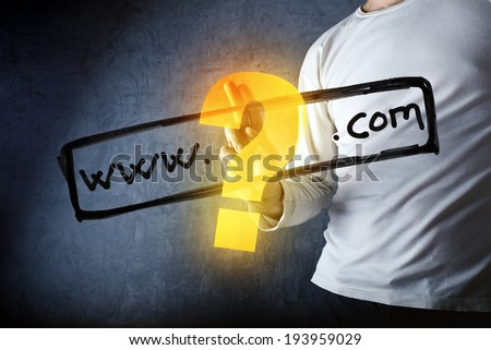 What is your com internet domain, conceptual image with man pushing virtual screen graphics. - stock photo