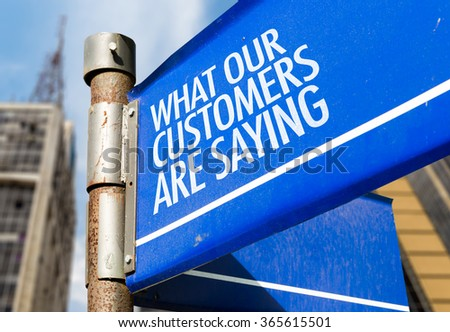 What Our Customers Are Saying written on road sign - stock photo