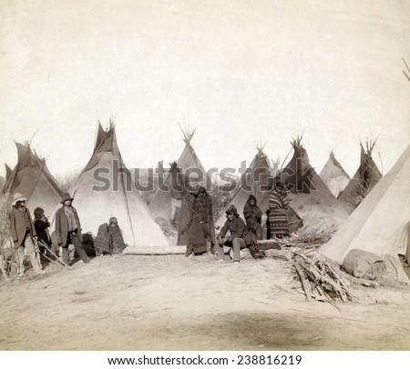 What's left of Big Foot's band. Miniconjou (children and adults)--in a tepee camp, probably on or near Pine Ridge Reservation. Pine Ridge, South Dakota. Photo by John C. Grabill. 1891 - stock photo