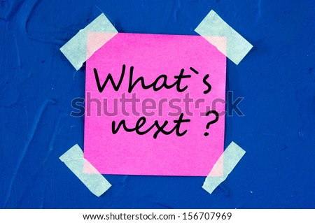 What's Next, written on an pink sticky paper - stock photo