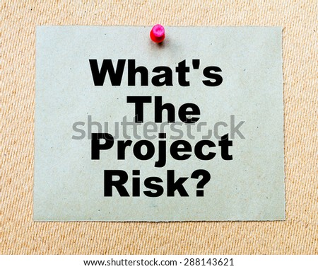 What's The Project Risk? written on paper note pinned with red thumbtack on wooden board. Business conceptual Image - stock photo