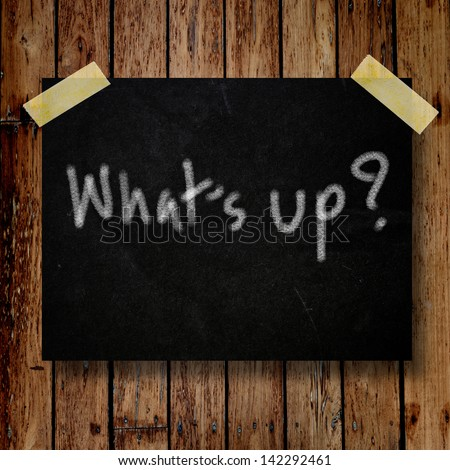 What's up on message note with wooden background - stock photo