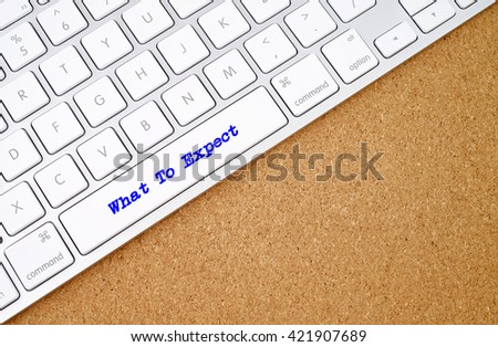What To Expect on computer keyboard background with copyspace area.  - stock photo