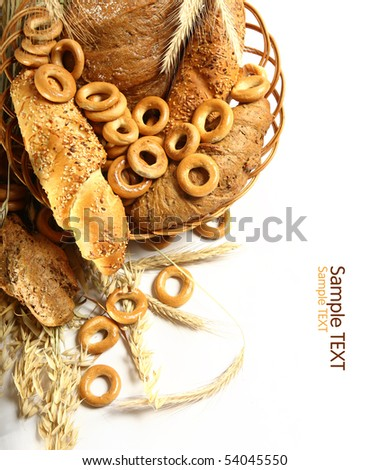 Wheat and bread over white - stock photo