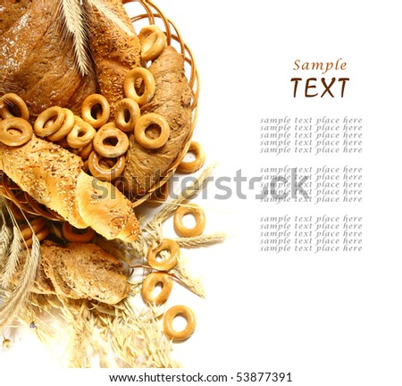 Wheat and bread over white background - stock photo