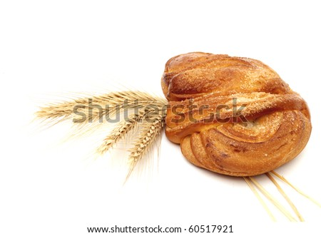 Wheat and bread over white background