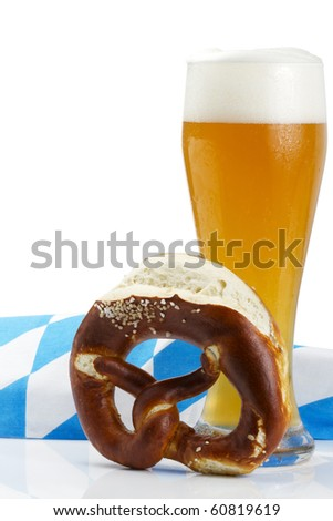 wheat beer with bavarian towel and pretzel on white background - stock photo