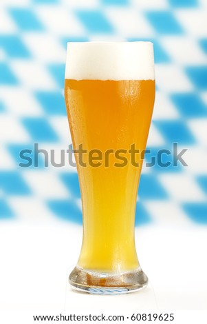 wheat beer with blue and white bavarian rhombus background - stock photo