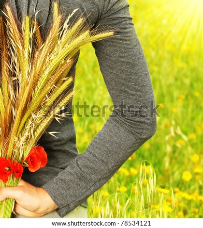 Wheat bouquet in girls hand, harvest concept - stock photo