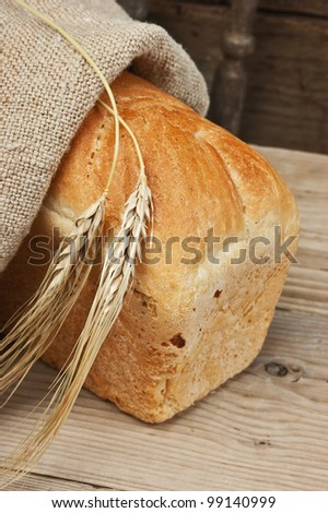 wheat bread on the wooden table - stock photo