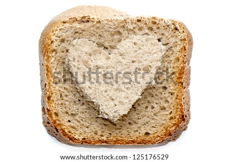 Wheat bread whole slice with a heart shape cut from the center