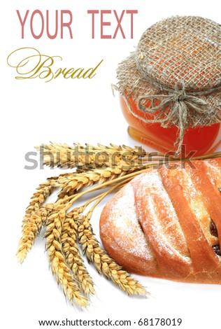 Wheat bread with honey jar - stock photo