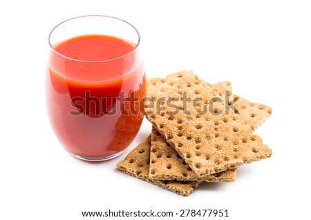 Wheat crisp bread and tomato juice in glass isolated on white background - stock photo