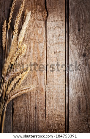 Wheat Ears on the Wooden Table - stock photo