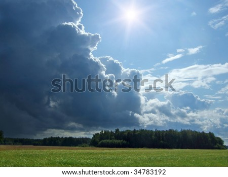 wheat field and rainy clouds - stock photo