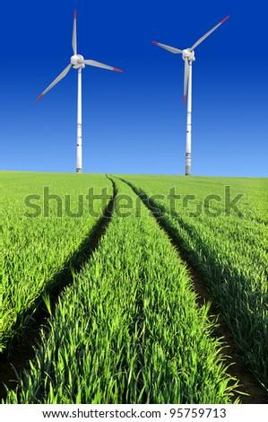wheat field with wind turbines - stock photo
