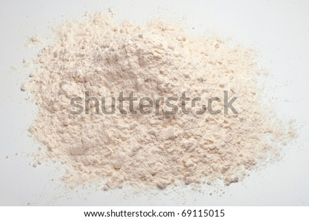 Wheat flour heap on a white background