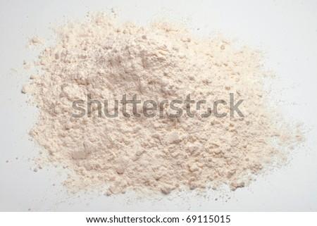 Wheat flour heap on a white background - stock photo