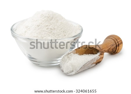 Wheat flour in bowl and scoop isolated on white - stock photo