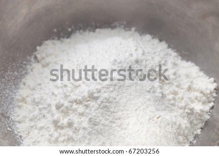 wheat flour in stainless bowl - stock photo