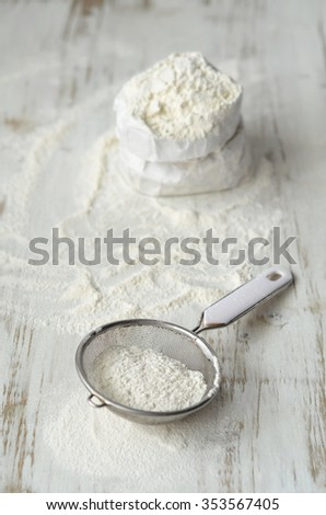 Wheat flour on a white wooden table