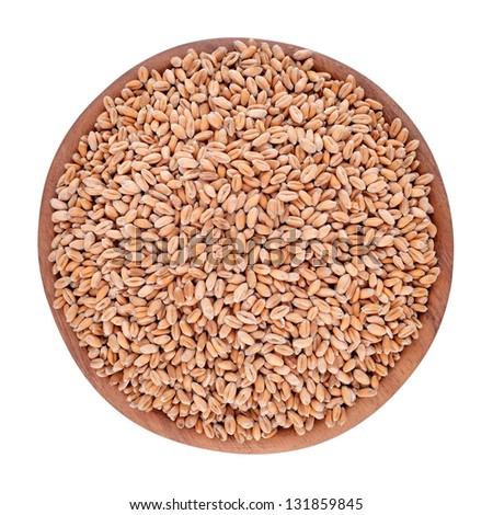 Wheat grains in a wooden bowl isolated on a white background - stock photo