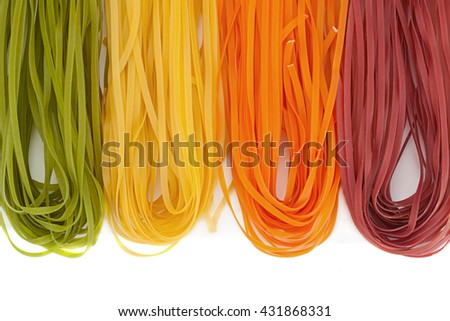 Wheat multicolored noodles isolated on white background