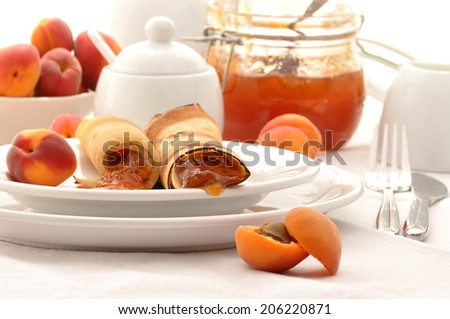 Wheat pancakes with homemade apricot jam - stock photo