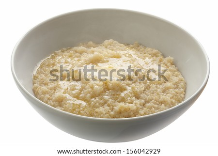 Wheat porridge with butter in the white bowl - stock photo