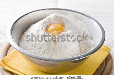 Wheat  white flour  with  egg yolk in cooking bowl