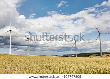 Wheatfield with windmills - stock photo