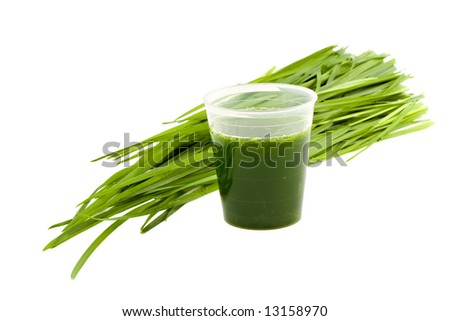 Wheatgrass drink & wheatgrass isolated on white background - stock photo