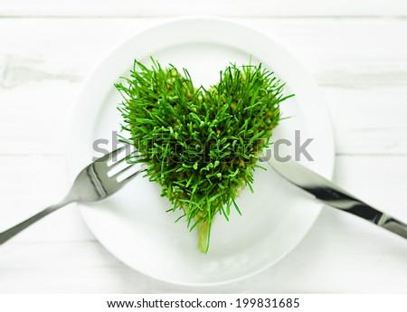 Wheatgrass heart concept, selective focus - stock photo
