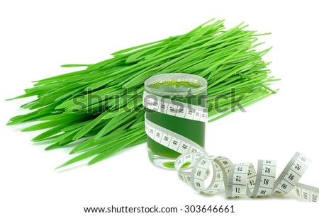 wheatgrass juice and tape isolated - stock photo
