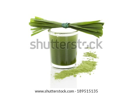 Wheatgrass powder, grass blades and green juice isolated on white background. Alternative medicine, detox. - stock photo