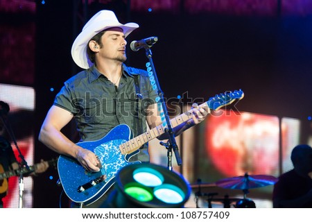 WHEATLAND, CA - JULY 23: Brad Paisley performs in The Escape Virtual Reality World Tour at Sleep Train Amphitheater in Wheatland, California on July 23, 2011 - stock photo