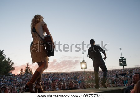 WHEATLAND, CA - JULY 23: The Band Perry opens for Brad Paisley for The Escape Virtual Reality World Tour at Sleep Train Amphitheater in Wheatland, California on July 23, 2011 - stock photo