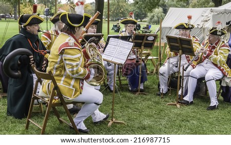 WHEATON, ILLINOIS/USA - SEPTEMBER 13, 2014: Unidentified members of Webb's Band of Music play a period piece with wind instruments at a reenactment of the American Revolutionary War (1775-1783).