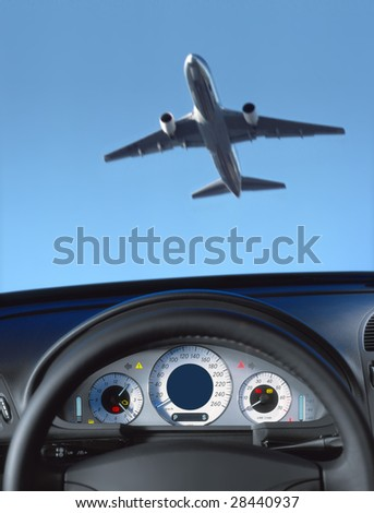 Wheel and dashboard of a car and view through the windshield on the aircraft - stock photo