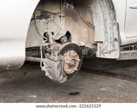 Wheel and disc break in maintenance process - stock photo