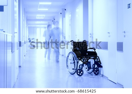 Wheel chair at corridor of hospital. - stock photo