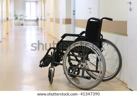 Wheel chair in the hospital corridor. - stock photo