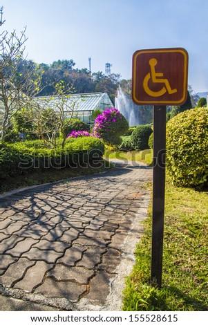 wheel chair sign in garden - stock photo