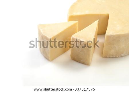 Wheel cheese on white background - stock photo
