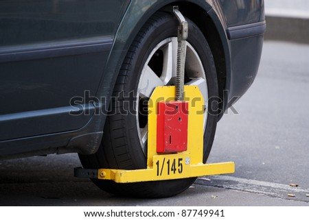 Wheel clamp - car immobilizer - stock photo
