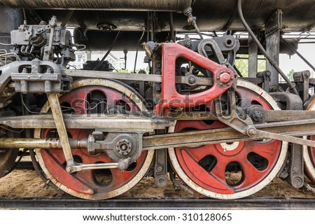 wheel detail of a vintage russian steam train locomotive - stock photo