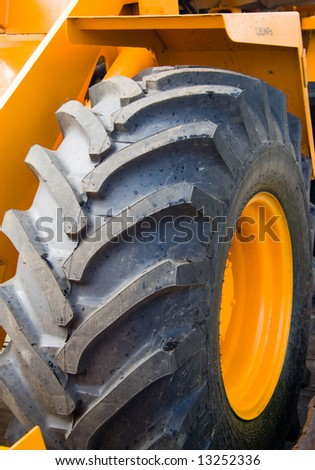 wheel grand loader's. Close-up - stock photo